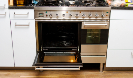 Big stainless steel stove in kitchen