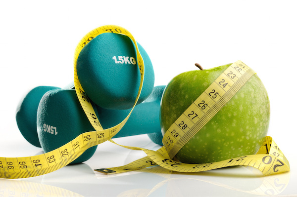 healthy apple, measuring tape and dumbbells isolated