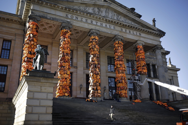 A art installation by Chinese artist Ai Weiwei with life  vests used by refugees and collected at the Greek island of Lesbos is set up at the Konzerthaus  Berlin (Concert Hall Berlin) for the Cinema For Peace gala alongside the 2016 Berlinale Film Festival in Berlin, Saturday, Feb. 13, 2016. The charity gala will take place at the Konzerthaus   on Monday, Feb. 15, 2016. (AP Photo/Markus Schreiber)
